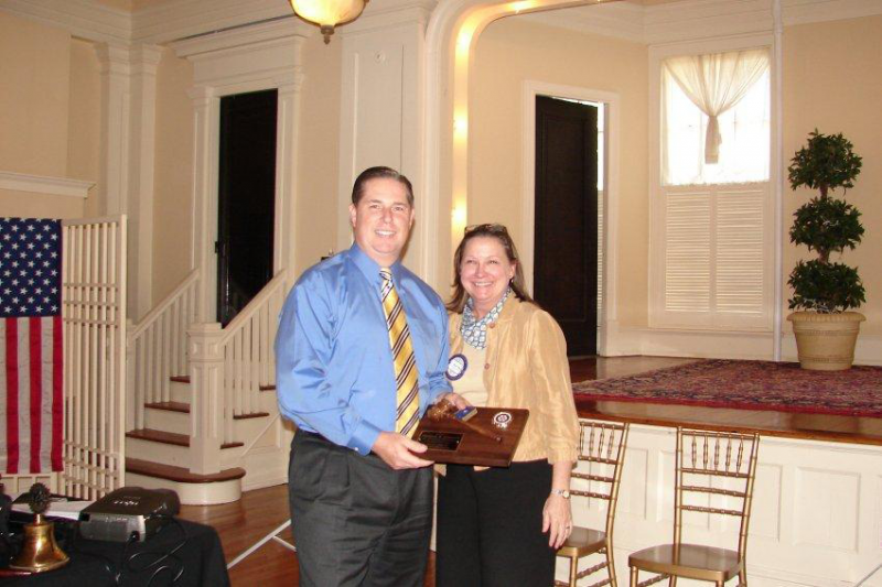 Patrick Johnson, Past President 2010-2011 passes the gavel to Beth Pline